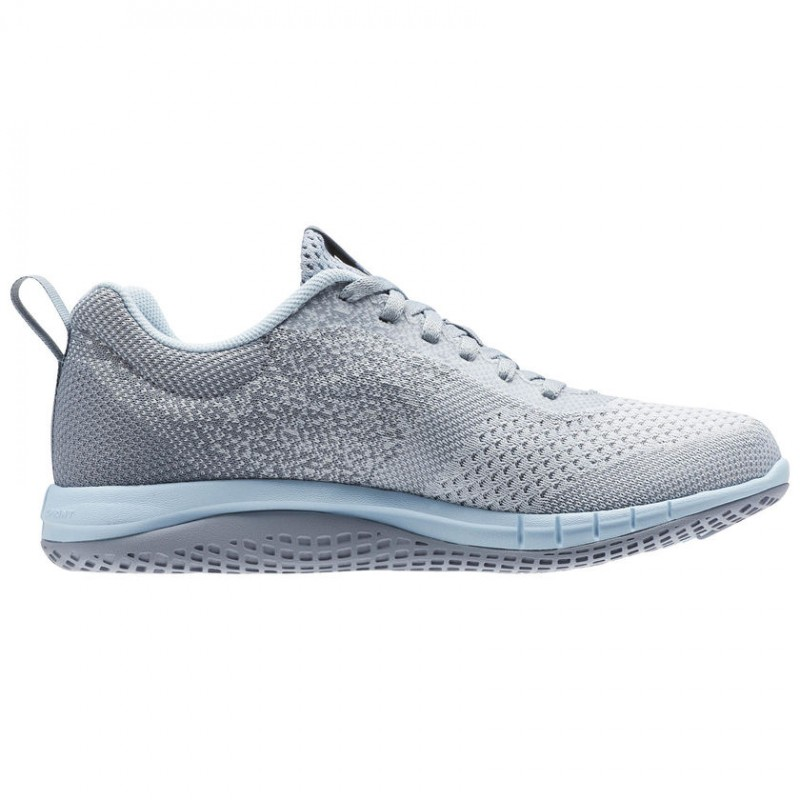 zapatos reebok de dama gris